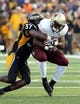 Aug 31, 2013; Hattiesburg, MS, USA; Texas State Bobcats running back Terrence Franks (20) is tackled by Southern Miss Golden Eagles linebacker Alan Howze (37) in the second quarter at M.M. Roberts Stadium. Mandatory Credit: Chuck Cook-USA TODAY Sports
