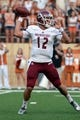 Aug 31, 2013; Austin, TX, USA; New Mexico State Aggies quarterback Andrew McDonald (12) drops back against the Texas Longhorns during the first half at Darrell K Royal-Texas Memorial Stadium. Mandatory Credit: Brendan Maloney-USA TODAY Sports