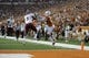 Aug 31, 2013; Austin, TX, USA; New Mexico State Aggies safety George Callender (5) intercepts a pass intended for Texas Longhorns wide receiver Mike Davis (1) during the first half at Darrell K Royal-Texas Memorial Stadium. Mandatory Credit: Brendan Maloney-USA TODAY Sports