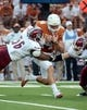 Aug 31, 2013; Austin, TX, USA; Texas Longhorns quarterback David Ash (14) carries the ball against the New Mexico State Aggies during the first half at Darrell K Royal-Texas Memorial Stadium. Mandatory Credit: Brendan Maloney-USA TODAY Sports