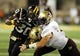 Aug 31, 2013; Hattiesburg, MS, USA; Southern Miss Golden Eagles running back Jalen Richard (30) is tackled by a pair of Texas State Bobcats defenders at M.M. Roberts Stadium. Texas State won, 22-15. Mandatory Credit: Chuck Cook-USA TODAY Sports