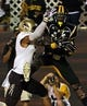 Aug 31, 2013; Hattiesburg, MS, USA; Southern Miss Golden Eagles wide receiver James Cox (15) makes a 6-yard touchdown catch while guarded by Texas State Bobcats cornerback Craig Mager (25) in the third quarter at M.M. Roberts Stadium.Texas State won, 22-15. Mandatory Credit: Chuck Cook-USA TODAY Sports