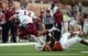 Aug 31, 2013; Austin, TX, USA; Texas Longhorns safety Mykkele Thompson (2) tackles New Mexico State Aggies quarterback Andrew McDonald (12) during the first half at Darrell K Royal-Texas Memorial Stadium. Texas beat New Mexico State 56-7. Mandatory Credit: Brendan Maloney-USA TODAY Sports