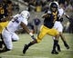 Aug 31, 2013; Berkeley, CA, USA; California Golden Bears running back Daniel Lasco (2) carries the ball against Northwestern Wildcats safety Jimmy Hall (9) during the third quarter at Memorial Stadium. Northwestern won 44-30. Mandatory Credit: Kelley L Cox-USA TODAY Sports