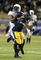 Aug 31, 2013; Berkeley, CA, USA; Northwestern Wildcats safety Ibraheim Campbell (24) intercepts the pass intended for California Golden Bears wide receiver Chris Harper (6) during the fourth quarter at Memorial Stadium. Northwestern won 44-30. Mandatory Credit: Kelley L Cox-USA TODAY Sports