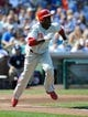 Sep 1, 2013; Chicago, IL, USA; Philadelphia Phillies left fielder Roger Bernadina (3) hits an infield single during the third inning against the Chicago Cubs at Wrigley Field. Mandatory Credit: Reid Compton-USA TODAY Sports
