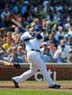 Sep 1, 2013; Chicago, IL, USA; Chicago Cubs first baseman Anthony Rizzo (44) hits an RBI double to deep right during the third inning against the Philadelphia Phillies at Wrigley Field. Mandatory Credit: Reid Compton-USA TODAY Sports
