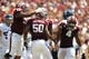 Aug 31, 2013; College Station, TX, USA; Texas A&M Aggies defensive lineman Alonzo Williams (90) celebrates a stop with linebacker Tyrone Taylor (50) against the Rice Owls during the second quarter at Kyle Field. Mandatory Credit: Thomas Campbell-USA TODAY Sports