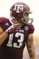 Aug 31, 2013; College Station, TX, USA; Texas A&M Aggies wide receiver Mike Evans (13) sets up against the Rice Owls during the third quarter at Kyle Field. Mandatory Credit: Thomas Campbell-USA TODAY Sports