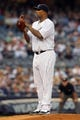 Aug 30, 2013; Bronx, NY, USA; New York Yankees starting pitcher CC Sabathia (52) pitches against the Baltimore Orioles during a game at Yankee Stadium. Mandatory Credit: Brad Penner-USA TODAY Sports