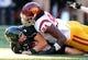 Aug 29, 2013; Honolulu, HI, USA; Southern California Trojans defensive end Leonard Williams (94) sacks Hawaii Rainbow Warriors quarterback Taylor Graham (8) at Aloha Stadium. Mandatory Credit: Kirby Lee-USA TODAY Sports
