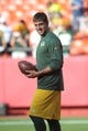 Aug 29, 2013; Kansas City, MO, USA; Green Bay Packers quarterback Aaron Rodgers (12) warms up before the game against the Kansas City Chiefs at Arrowhead Stadium. The Chiefs won 30-8. Mandatory Credit: Denny Medley-USA TODAY Sports