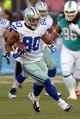 Aug 4, 2013; Canton, OH, USA; Dallas Cowboys tight end Dante Rosario (80) carries the ball against the Miami Dolphins  in the 2013 Hall of Fame Game at Fawcett Stadium.  Mandatory Credit: Kirby Lee-USA TODAY Sports
