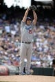 Sept 2, 2013; Denver, CO, USA; Los Angeles Dodgers starting pitcher Clayton Kershaw (22) prepares to deliver a pitch in the first inning against the Colorado Rockies at Coors Field. Mandatory Credit: Ron Chenoy-USA TODAY Sports