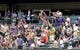 Sept 2, 2013; Denver, CO, USA; Fans attempt to grab a foul baseball during the game the Los Angeles Dodgers and the Colorado Rockies at Coors Field. Mandatory Credit: Ron Chenoy-USA TODAY Sports