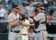 Sep 2, 2013; Cleveland, OH, USA; Baltimore Orioles relief pitcher Brian Matusz (17) and Baltimore Orioles catcher Matt Wieters (32) celebrate after the Orioles beat the Cleveland Indians 7-2 at Progressive Field. Mandatory Credit: Ken Blaze-USA TODAY Sports
