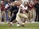 Sep 2, 2013; Pittsburgh, PA, USA; Florida State Seminoles fullback Chad Abram (41) carries the ball past Pittsburgh Panthers defensive lineman Tyrone Ezell (50) during the fourth quarter at Heinz Field. The Florida State Seminoles won 41-13. Mandatory Credit: Charles LeClaire-USA TODAY Sports