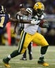 Aug 17, 2013; St. Louis, MO, USA; Green Bay Packers running back Eddie Lacy (27) carries the ball during the first half at the Edward Jones Dome. Mandatory Credit: Jeff Curry-USA TODAY Sports
