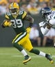 Aug 23, 2013; Green Bay, WI, USA; Green Bay Packers wide receiver James Jones (89) rushes with the football after catching a pass during the first quarter against the Seattle Seahawks at Lambeau Field.  Seattle won 17-10.  Mandatory Credit: Jeff Hanisch-USA TODAY Sports