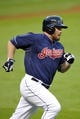 Sep 3, 2013; Cleveland, OH, USA; Cleveland Indians right fielder Jason Kubel (12) rounds the bases on a double in the second inning against the Baltimore Orioles at Progressive Field. Mandatory Credit: David Richard-USA TODAY Sports