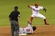 Sep 3, 2013; Philadelphia, PA, USA; Philadelphia Phillies shortstop Freddy Galvis (13) jumps over Washington Nationals center fielder Denard Span (2) after forcing him at second base during the third inning at Citizens Bank Park. Mandatory Credit: Howard Smith-USA TODAY Sports