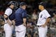 Sep 3, 2013; Bronx, NY, USA; New York Yankees catcher Chris Stewart (19) and pitching coach Larry Rothschild (58) talk with starting pitcher Hiroki Kuroda (18) during the fifth inning of a game against the Chicago White Sox at Yankee Stadium. Mandatory Credit: Brad Penner-USA TODAY Sports