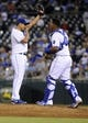 Sep 3, 2013; Kansas City, MO, USA; Kansas City Royals catcher Salvador Perez (13) talks to starting pitcher Bruce Chen (52) in the sixth inning against the Seattle Mariners at Kauffman Stadium. Mandatory Credit: John Rieger-USA TODAY Sports