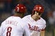Sep 3, 2013; Philadelphia, PA, USA; Philadelphia Phillies third baseman Cody Asche (25) celebrates hitting a home run with third base coach Juan Samuel (8) during the eighth inning against the Washington Nationals at Citizens Bank Park. The Nationals defeated the Phillies 9-6. Mandatory Credit: Howard Smith-USA TODAY Sports