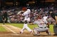 Sep 3, 2013; Philadelphia, PA, USA; Philadelphia Phillies second baseman Chase Utley (26) hits an RBI single during the sixth inning against the Washington Nationals at Citizens Bank Park. The Nationals defeated the Phillies 9-6. Mandatory Credit: Howard Smith-USA TODAY Sports