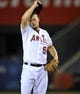 September 3, 2013; Anaheim, CA, USA; Los Angeles Angels starting pitcher Joe Blanton (55) wipes his face during the eighth inning at Angel Stadium of Anaheim. Mandatory Credit: Gary A. Vasquez-USA TODAY Sports