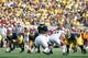 Aug 31, 2013; Ann Arbor, MI, USA; Michigan Wolverines quarterback Devin Gardner (12) gets set to run a play against the Central Michigan Chippewas at Michigan Stadium. Mandatory Credit: Rick Osentoski-USA TODAY Sports