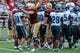 Aug 31, 2013; Boston, MA, USA; The Villanova Wildcats and the Boston College Eagles meet at midfield after the Eagles defeated the Wildcats at Alumni Stadium. Mandatory Credit: Bob DeChiara-USA TODAY Sports
