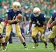 Aug 31, 2013; South Bend, IN, USA; Notre Dame Fighting Irish quarterback Tommy Rees (11) hands off to running back George Atkinson III (4) in the first quarter against the Temple Owls at Notre Dame Stadium. Notre Dame won 28-6. Mandatory Credit: Matt Cashore-USA TODAY Sports