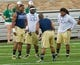 Aug 31, 2013; South Bend, IN, USA; Notre Dame Fighting Irish defensive lineman Stephon Tuitt, left, defensive lineman Louis Nix, center, and defensive lineman Sheldon Day, right, warm up before the game against the Temple Owls at Notre Dame Stadium. Notre Dame won 28-6. Mandatory Credit: Matt Cashore-USA TODAY Sports