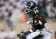 Aug 30, 2013; East Lansing, MI, USA; Michigan State Spartans wide receiver Tony Lippett (14) runs with the ball after the catch against the Western Michigan Broncos during 1st half of a game at Spartan Stadium.   Mandatory Credit: Mike Carter-USA TODAY Sports