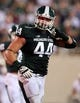 Aug 30, 2013; East Lansing, MI, USA; Michigan State Spartans defensive end Marcus Rush (44) walks off the field in game against the Western Michigan Broncos during 2nd  half of a game at Spartan Stadium. MSU won 26-13.   Mandatory Credit: Mike Carter-USA TODAY Sports