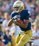 Aug 31, 2013; South Bend, IN, USA; Notre Dame Fighting Irish running back George Atkinson III (4) runs the ball in the third quarter against the Temple Owls at Notre Dame Stadium. Notre Dame won 28-6. Mandatory Credit: Matt Cashore-USA TODAY Sports