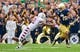Aug 31, 2013; South Bend, IN, USA; Temple Owls defensive back Abdul Smith (21) attempts to tackle Notre Dame Fighting Irish wide receiver TJ Jones (7) in the first quarter at Notre Dame Stadium. Notre Dame won 28-6. Mandatory Credit: Matt Cashore-USA TODAY Sports