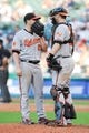 Sep 2, 2013; Cleveland, OH, USA; Baltimore Orioles starting pitcher Bud Norris (25) and catcher Matt Wieters (32) talk on the mound against the Cleveland Indians at Progressive Field. Mandatory Credit: Ken Blaze-USA TODAY Sports