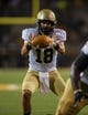 Aug 31, 2013; Waco, TX, USA; Wofford Terriers quarterback James Lawson (18) takes the snap during the game against the Baylor Bears at Floyd Casey Stadium. The Bears defeated the Terriers 69-3. Mandatory Credit: Jerome Miron-USA TODAY Sports