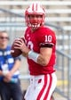 Aug 31, 2013; Madison, WI, USA; Wisconsin Badgers quarterback Curt Phillips (10) warms up prior to the game against the Massachusetts Minutemen at Camp Randall Stadium.  Wisconsin won 45-0.  Mandatory Credit: Jeff Hanisch-USA TODAY Sports