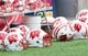 Aug 31, 2013; Madison, WI, USA; Wisconsin Badgers helmets sit on the field during warmups prior to the game against the Massachusetts Minutemen at Camp Randall Stadium.  Wisconsin won 45-0.  Mandatory Credit: Jeff Hanisch-USA TODAY Sports