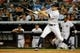 Sep 4, 2013; Bronx, NY, USA;  New York Yankees center fielder Brett Gardner (11) triples to deep left allowing two runners to score during the fourth inning against the Chicago White Sox at Yankee Stadium. Mandatory Credit: Anthony Gruppuso-USA TODAY Sports