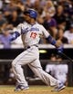 Sep 4, 2013; Denver, CO, USA; Los Angeles Dodgers shortstop Hanley Ramirez (13) hits a single during the sixth inning against the Colorado Rockies at Coors Field. Mandatory Credit: Chris Humphreys-USA TODAY Sports