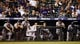 Sep 4, 2013; Denver, CO, USA; Members of the Los Angeles Dodgers watch from the dugout during the eighth inning against the Colorado Rockies at Coors Field. The Rockies won 7-5.  Mandatory Credit: Chris Humphreys-USA TODAY Sports
