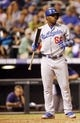 Sep 4, 2013; Denver, CO, USA; Los Angeles Dodgers pinch hitter Yasiel Puig (66) during the eighth inning against the Los Angeles Dodgers at Coors Field. The Rockies won 7-5.  Mandatory Credit: Chris Humphreys-USA TODAY Sports