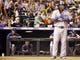 Sep 4, 2013; Denver, CO, USA; Los Angeles Dodgers manager Don Mattingly (far left) watches pinch hitter Yasiel Puig (66) during the eighth inning against the Los Angeles Dodgers at Coors Field. The Rockies won 7-5.  Mandatory Credit: Chris Humphreys-USA TODAY Sports
