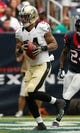 Aug 25, 2013; Houston, TX, USA; New Orleans Saints wide receiver Kenny Stills (84) catches a pass for a touchdown during the first half at Reliant Stadium. Mandatory Credit: Thomas Campbell-USA TODAY Sports