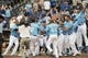 Sep 5, 2013; Kansas City, MO, USA; Kansas City Royals third baseman Mike Moustakas (8) is congratulated by his teammates after hitting the game winning home run in the thirteenth inning of the game against the Seattle Mariners at Kauffman Stadium. The Royals won 7-6. Mandatory Credit: Denny Medley-USA TODAY Sports