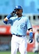Sep 5, 2013; Kansas City, MO, USA; Kansas City Royals second baseman Emilio Bonifacio (64) signals to the crowd after hitting a single in the fifth inning of the game against the Seattle Mariners at Kauffman Stadium. The Royals won 7-6. Mandatory Credit: Denny Medley-USA TODAY Sports